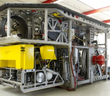 Rockpiper fall pipe ROV with survey ROV in docking position