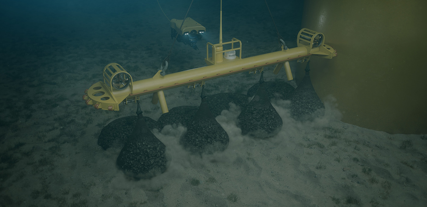 Subsea lifting beam for rock bag installation around monopiles